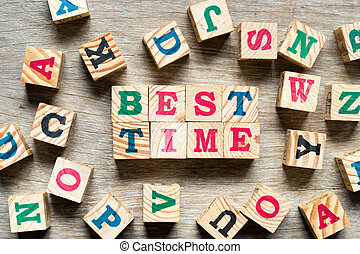 Letter block in word best time with another alphabet on wood background