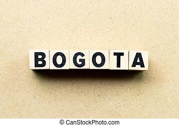 Letter block in word Bogota on wood background