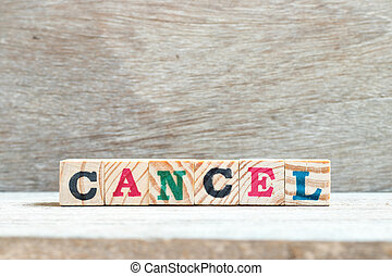 Letter block in word cancel on wood background