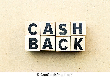 Letter block in word cash back on wood background