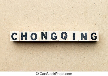 Letter block in word Chongqing on wood background