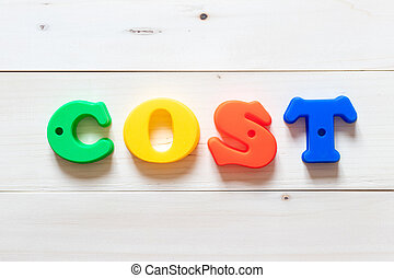 Letter block in word cost on white wood background