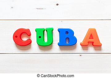 Letter block in word Cuba on white wood background
