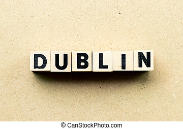 Letter block in word Dublin on wood background
