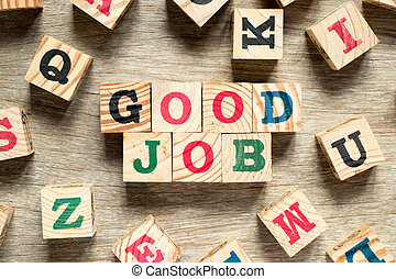 Letter block in word good job with another on wood background