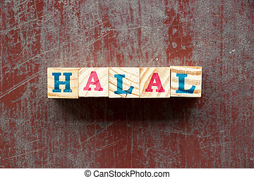 Letter block in word halal on old red wood background