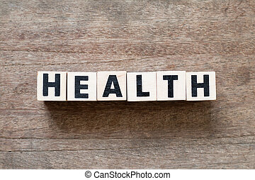 Letter block in word health on wood background