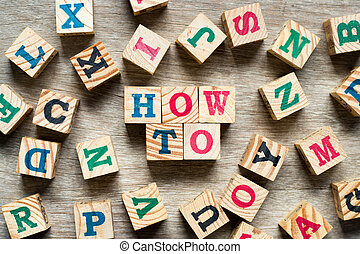 Letter block in word how to with another alphabet on wood background