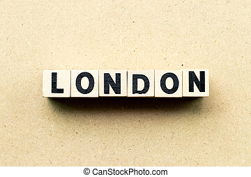 Letter block in word London on wood background