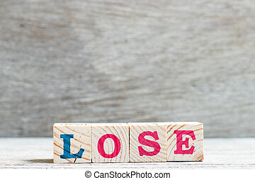 Letter block in word lose on wood background