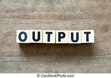Letter block in word output on wood background