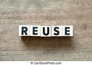 Letter block in word reuse on wood background