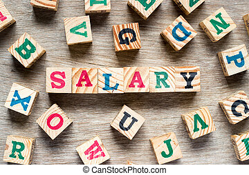 Letter block in word salary with another alphabet on wood background