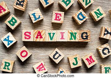 Letter block in word saving with another alphabet on wood background