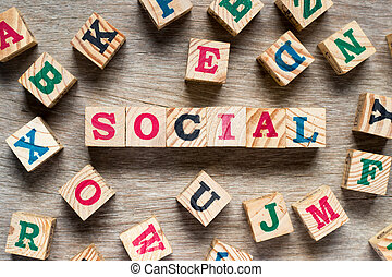 Letter block in word social with another alphabet on wood background