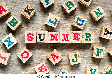 Letter block in word summer with another alphabet on wood background