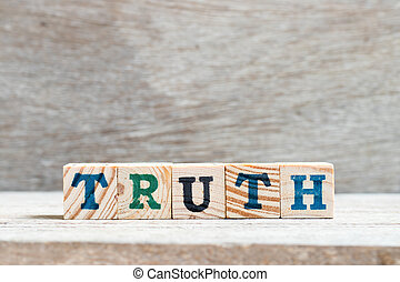 Letter block in word truth on wood background