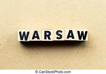 Letter block in word Warsaw on wood background