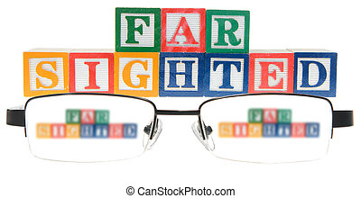 Letter blocks spelling far sighted with a pair of glasses....