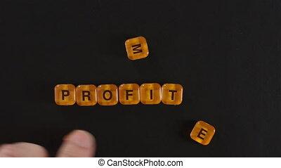 Letter Blocks Spelling More Profit