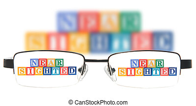 Letter blocks spelling near sighted with a pair of glasses. Isolated on a white background.