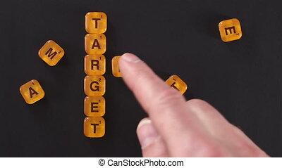 Letter Blocks Target Market Words - A close up shot of a man...