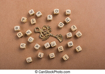 Letter cubes of made of wood around key
