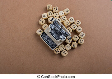 Letter cubes of made of wood around typewritter