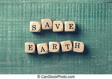 Letter cubes with word save earth