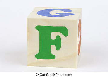 letter F - isolated brick on the white background, focus ...