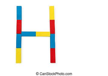 Letter H is folded of wooden blocks