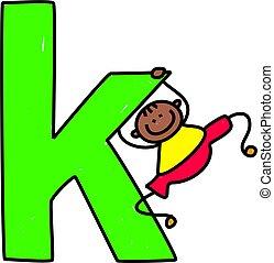 letter K boy - happy little ethnic boy swinging on giant...