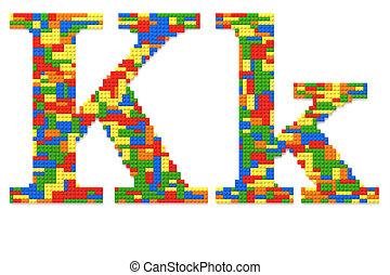Letter K built from random colors toy bricks