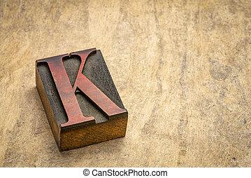 letter K in letterpress wood type