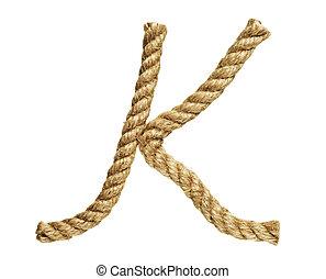 Letter K - old natural fiber rope bent in the form of letter...