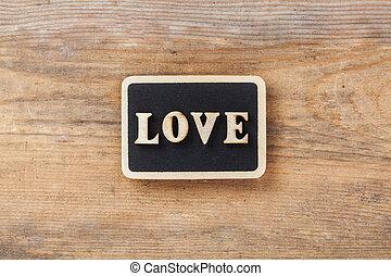 Letter Love on wooden background