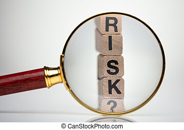 Risk Word With Help Of Magnifying Glass