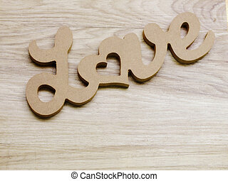 letter text love word wooden on wooden background with space copy