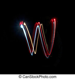 Letter W made from brightly coloured neon lights