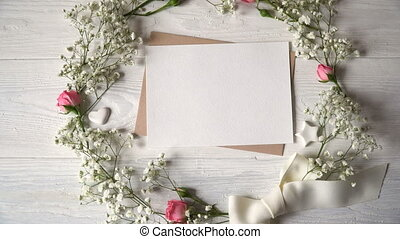 Letter with wreath of flowers greeting card for St. Valentine's Day in rustic style with place for your text, Flat lay, top view