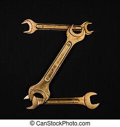 Letter Z. Alphabet made of golden repair tools. Creative...
