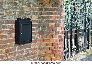 Letterbox and iron gates of a home