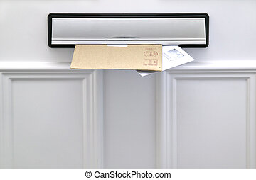 Letterbox and letters - Two letters sticking out of a...