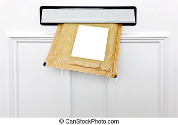 Letterbox and padded envelope - A padded envelope in the...