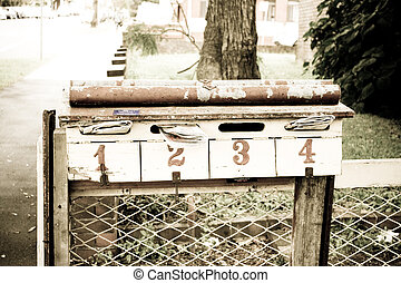 Letterbox with mail and numbers 1, 2, 3, 4