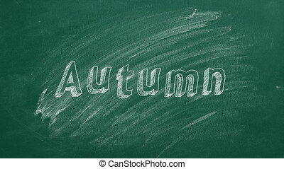 """Lettering """"Autumn"""" on greenboard. Back to school."""
