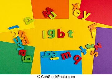 Lettering LGBT. On a yellow background. Top view
