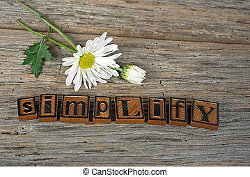 letterpress type with daisy