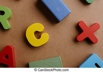 Letters and blocks on a wooden background