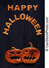 Letters and pumpkin of dough on the wooden table. Halloween...